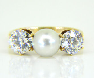 Pearl and diamond three-stone ring