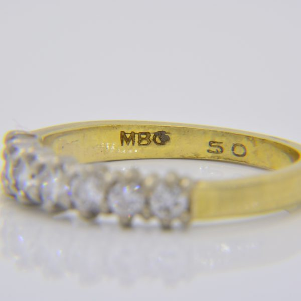 Diamond 7-stone half eternity ring