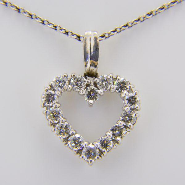 Platinum, diamond open heart pendant