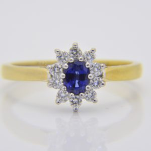 Sapphire & diamond oval cluster ring