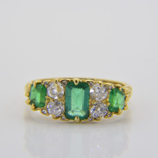 Emerald and diamond 7-stone ring