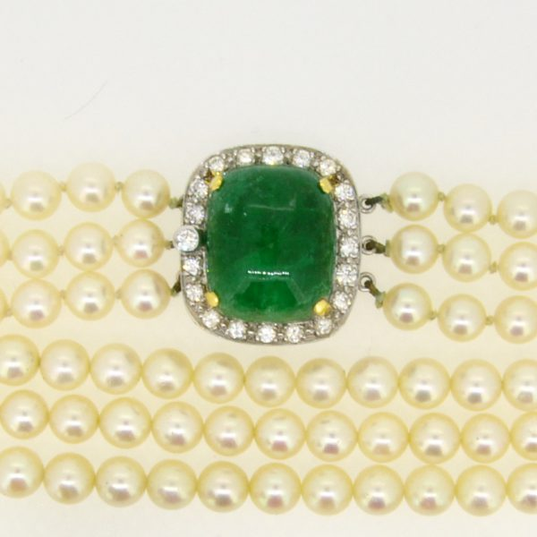 Cultured pearl choker with emerald and diamond clasp