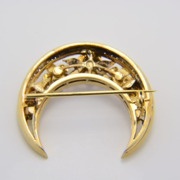Enamelled gold crescent brooch