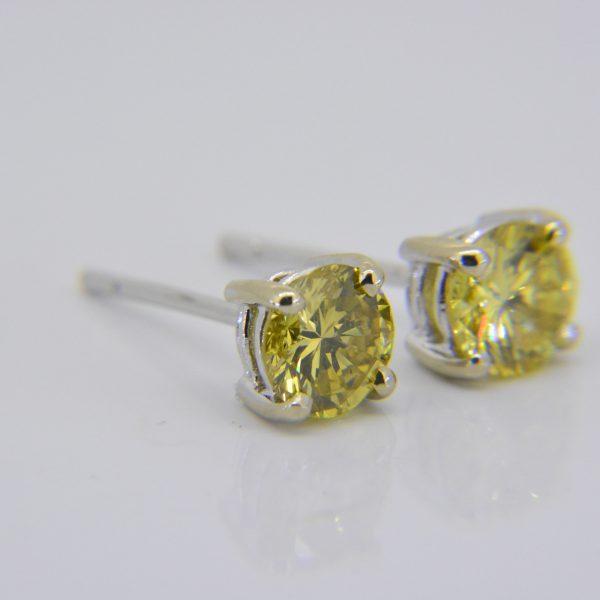 1.51ct fancy yellow diamond studs