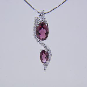 18ct, pink tourmaline & diamond pendant