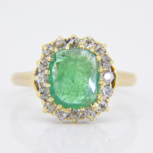 Gold, emerald & diamond cluster ring
