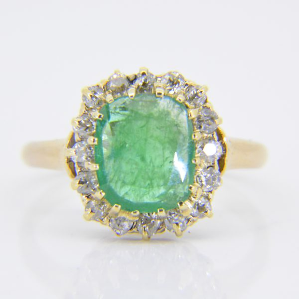 Gold, emerald & diamond cluster ring