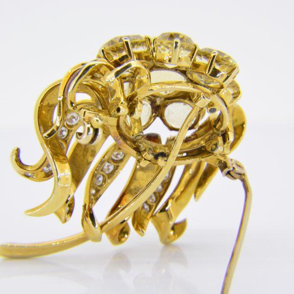 Topaz, diamond, enamel brooch