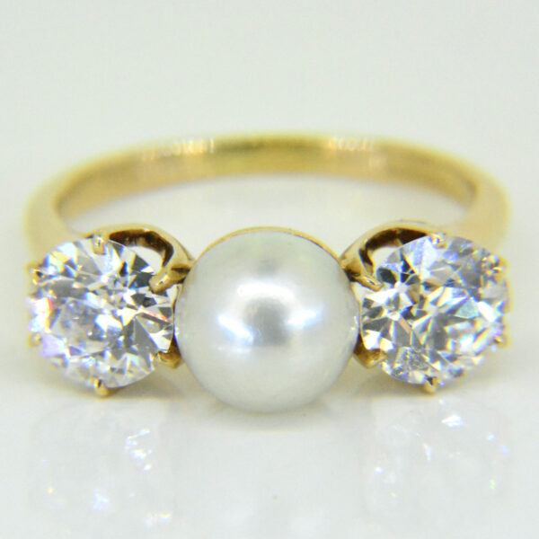Pearl and diamond three-stone ring