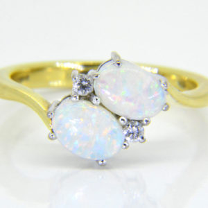 18ct opal diamond cross over ring