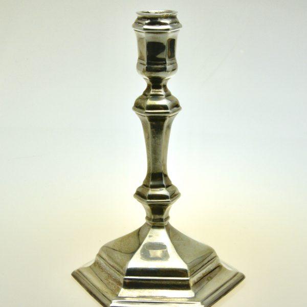 Set 4 cast silver candlesticks