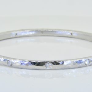 Arts and Crafts style platinum diamond bangle