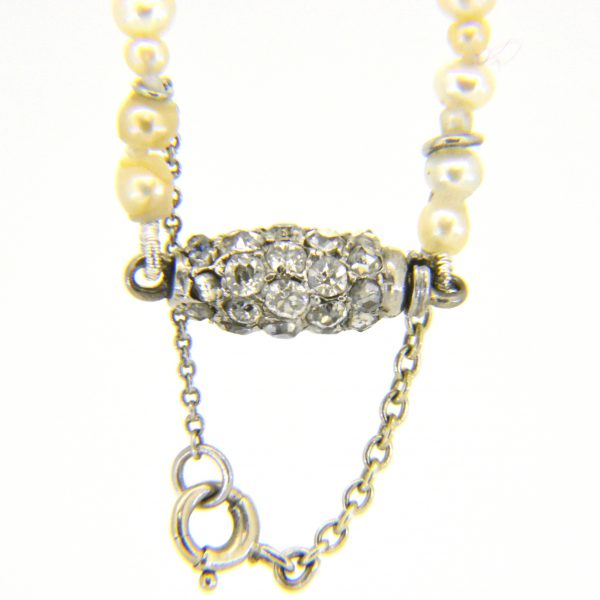 Diamond clasp on pearl necklace